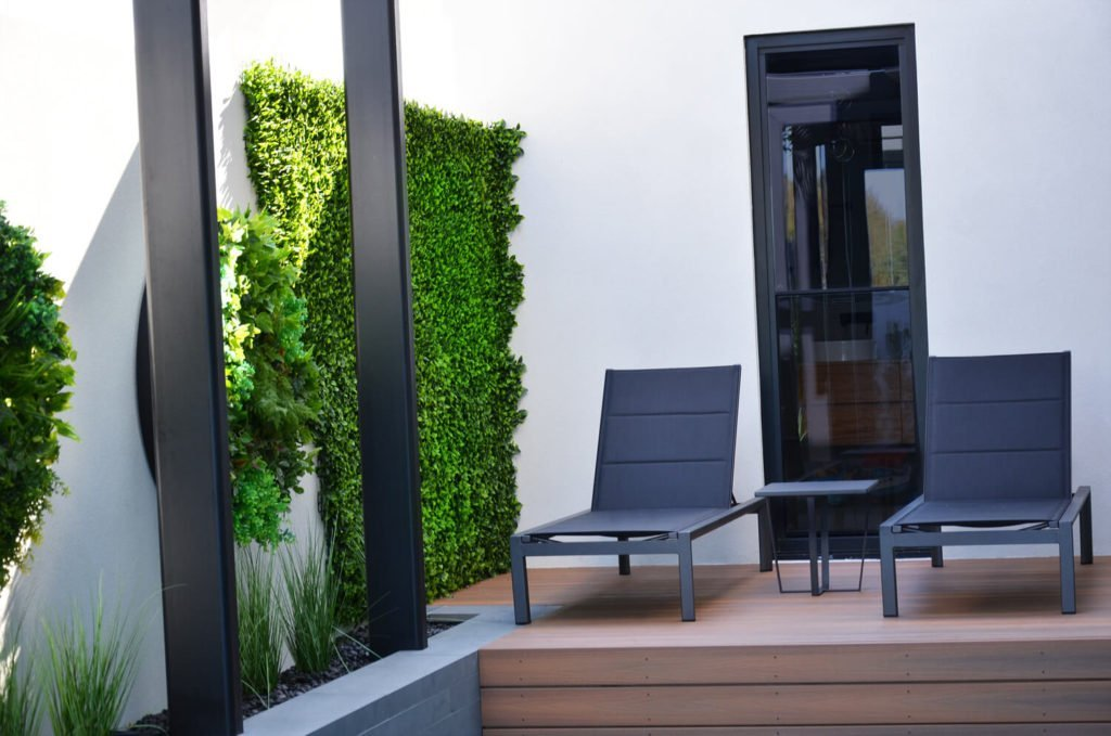 plants along a pool and deck area
