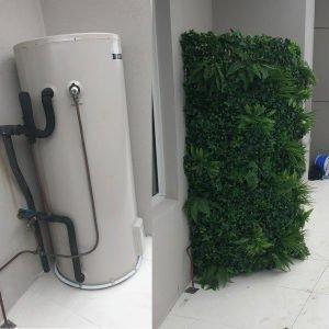 Fake green wall around a water tank