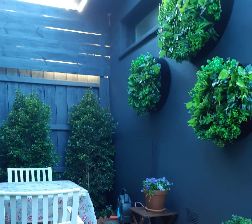 artificial green wall discs on a fence
