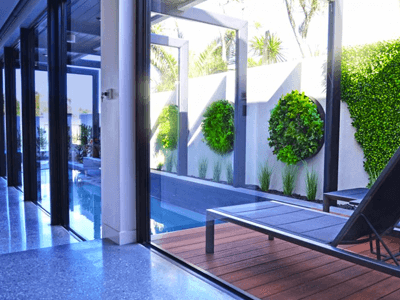 Improve property value - pool with artficial green wall disks - property for sale