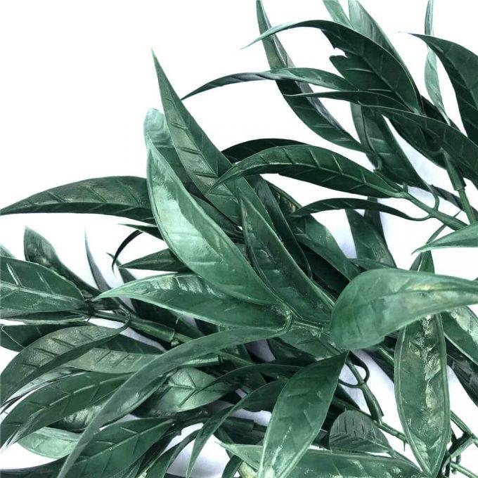 Dark green artificial floral arrangement plant