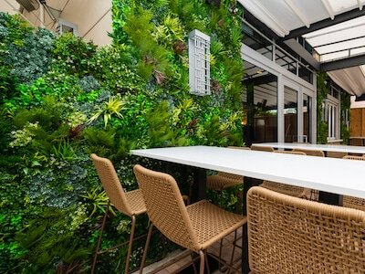 Artificial fire tested green wall for cafe