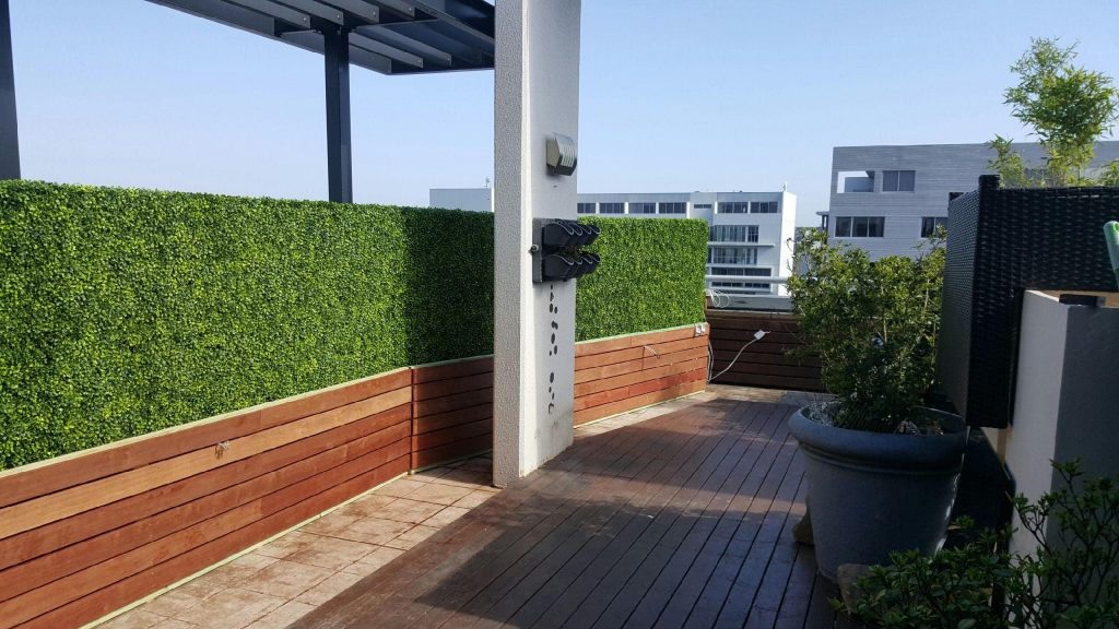 portable fake hedges installed on a balcony