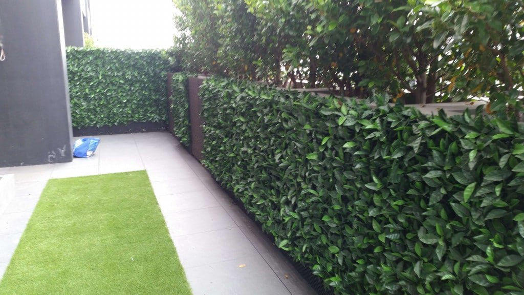penthouse green wall installation with hedge panels