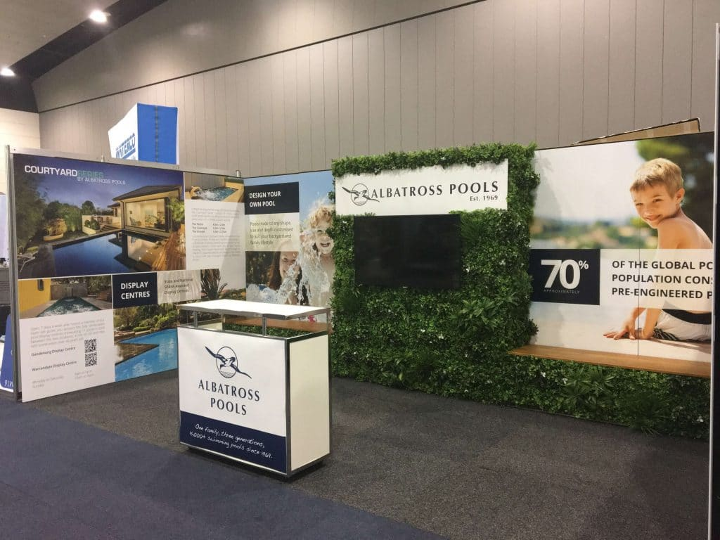 Trade show backdrop with greenery