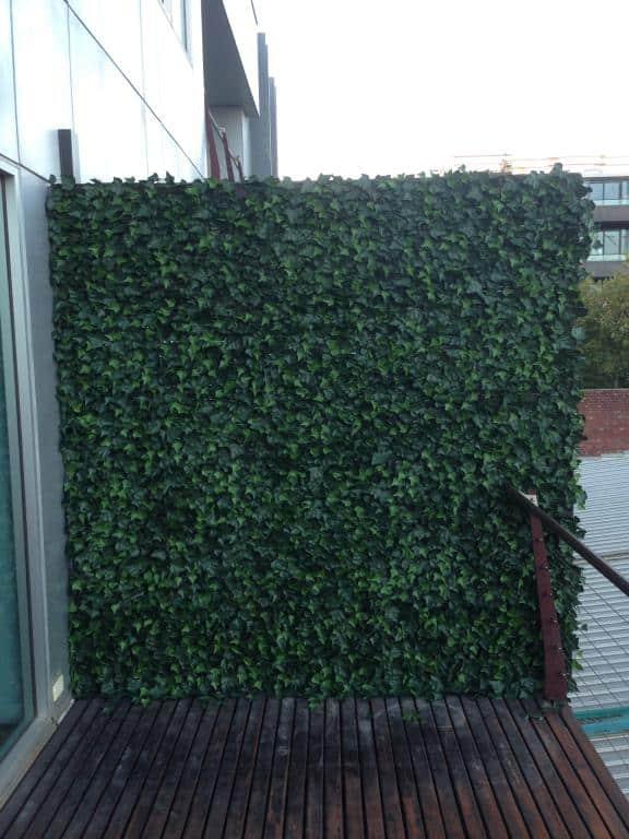 fake ivy panels installed onto a balcony
