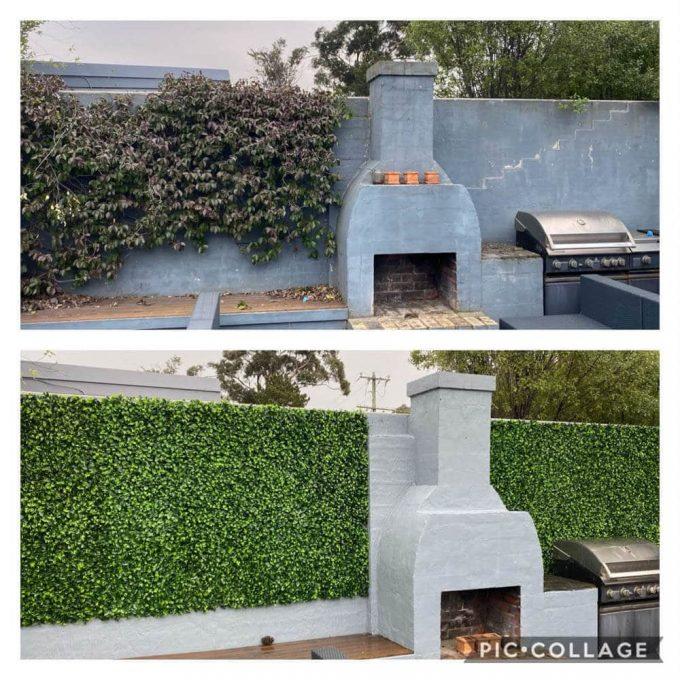 fake hedge panels installed onto a brick wall